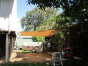 Install metal posts and mounting bracket onto house to install Shade Sail.