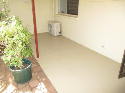 Pressure clean existing flaky paint and paint concrete to freshen up.