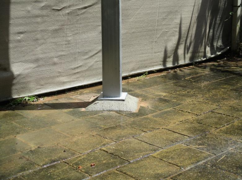 Concrete casting plate into place and weld new post onto plate to secure existing shade sail.