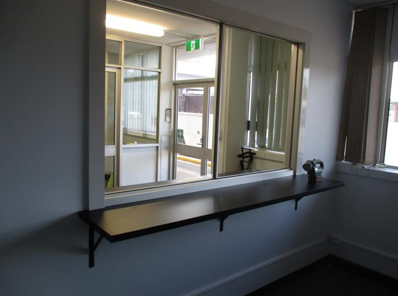 Install window with shelf for access in office.