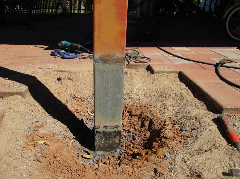 Remove and replace rusted section of post to elevated house, painted to match.